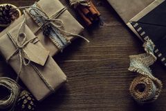 Presents in rustic wrap, wood background Stock Image