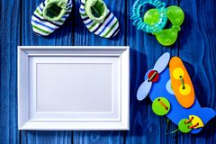 Presents set for baby shower with frame blue wooden background t. Presents set for baby shower with frame on blue wooden background top view mockup stock image