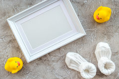 Presents set for baby shower with frame gray stone background top view mockup Royalty Free Stock Images