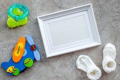 Presents set for baby shower with frame gray stone background top view mockup. Presents set for baby shower with frame on gray stone background top view mockup stock image
