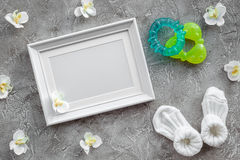 Presents set for baby shower with orchid and frame gray stone background top view mockup. Presents set for baby shower with orchid flower and frame on gray stone royalty free stock photo
