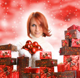 Presents and shiny balls Stock Image