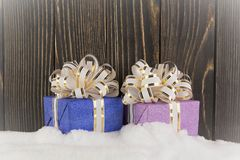 Presents on a snow background Stock Photos