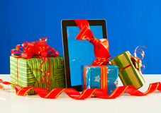 Presents with a tablet pc Royalty Free Stock Photo