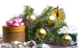 Presents time (christmas). Pine tree with gold ornaments, clock, gifts Royalty Free Stock Images