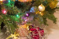 Presents under christmas tree. At night Stock Photo