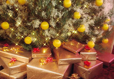 Presents under Christmas tree. Shiny presents under a sparkling Christmas tree Royalty Free Stock Image