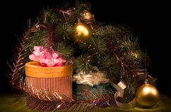 Presents under the christmas tree. Gold ornaments boxes Stock Photo