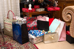 Presents under christmas tree Stock Image