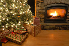 Presents under the Christmas tree. Christmas eve scene in a living room Royalty Free Stock Photos