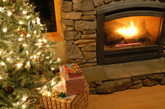Presents under the Christmas tree. Christmas eve scene in a living room Royalty Free Stock Photo