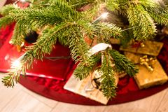 Presents under the christmas tree. Colorful presents under the christmas tree with lights on Stock Images