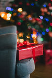 Presents under the Christmas tree lights background. Holiday mood Stock Photography