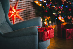 Presents under the Christmas tree lights background. Holiday mood Stock Images