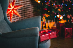 Presents under the Christmas tree lights background. Holiday mood Stock Photos