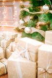 Presents under Christmas Tree in living room. Family Holiday New Year at Home Stock Photos