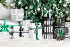 Presents under Christmas Tree in living room. Family Holiday New Year at Home. Close up Royalty Free Stock Images