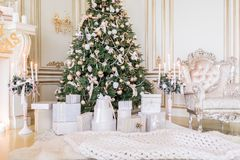 Presents under Christmas Tree in living room. Family Holiday New Year at Home. Close up Royalty Free Stock Photo