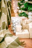 Presents under Christmas Tree in living room. Family Holiday New Year at Home Stock Photography
