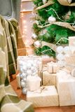 Presents under Christmas Tree in living room. Family Holiday New Year at Home Royalty Free Stock Images