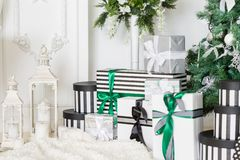 Presents under Christmas Tree in living room. Family Holiday New Year at Home. Close up stock photography