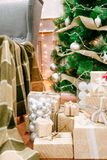 Presents under Christmas Tree in living room. Family Holiday New Year at Home Royalty Free Stock Photos