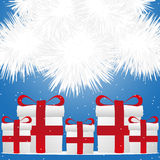 Presents under Christmas tree snow Stock Images