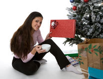 Presents under the tree. Woman with presents under Christmas tree Stock Photos