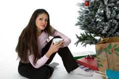 Presents under the tree. Woman with presents under Christmas tree Royalty Free Stock Photos