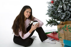 Presents under the tree. Woman with presents under Christmas tree Stock Image