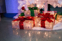 Presents under tree. Some shiny presents under tree Royalty Free Stock Images
