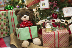 Presents underneath a Christmas Tree. Teddy Bear with gifts and presents underneigh a Christmas tree royalty free stock images