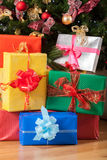 Presents underneath the tree. Colorful Christmas presents underneath the Christmas tree royalty free stock photography