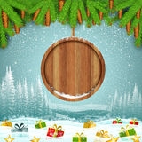 Presents on winter frost landscape with round wood border from fir tree branch. Gift boxes on winter frost landscape with round wood border from fir tree Stock Images