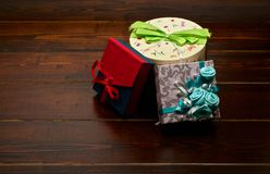 Presents on the wooden table. Three presents on the dark brown wooden table royalty free stock photos