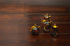 Presents on the wooden table. Three decorations on the dark wooden floor in russian style stock photography