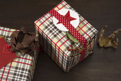 Presents wrapped in checkered paper and brown ribbon with label Royalty Free Stock Images