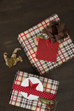 Presents wrapped in checkered paper and brown ribbon with label Stock Photo