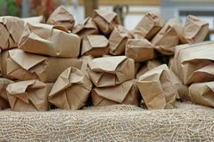 Presents wrapped in Kraft paper on burlap. Presents wrapped in Kraft paper lie on burlap Stock Photos