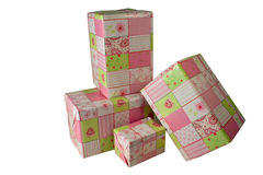 Presents wrapped in pink gift paper - 1. Presents wrapped in green and pink gift paper with hearts Royalty Free Stock Photos