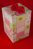 Presents wrapped in pink gift paper - 6. Presents wrapped in green and pink gift paper with hearts Stock Image