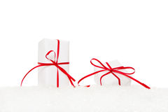 Presents wrapped in white paper and tied with red ribbon Royalty Free Stock Photos