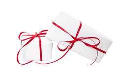 Presents wrapped in white paper and tied with red ribbon Royalty Free Stock Images