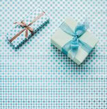Presents on wrapping paper. Top view of presents decorated with ribbons on wrapping paper Royalty Free Stock Photos