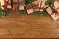 Presents for xmas or new year concept. Border of grey packages with red, green ribbons. Stock Photo