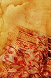 Presents with Yellowed and Stained Paper. Presents tied with ribbon with textured vintage paper stained and torn with age. Space for your own text stock illustration
