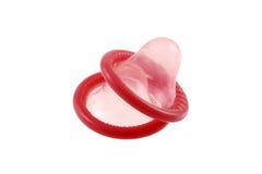 Preservativo doble (dos preservativos) aislado en blanco Foto de archivo