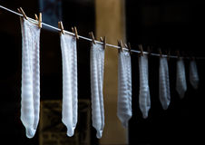 Preservativos em tamanhos diferentes Fotografia de Stock