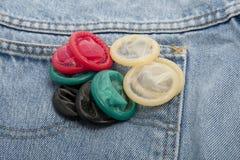 Preservativos en diversos colores Fotos de archivo
