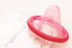Preservativos vermelhos - rotes Kondom Imagem de Stock